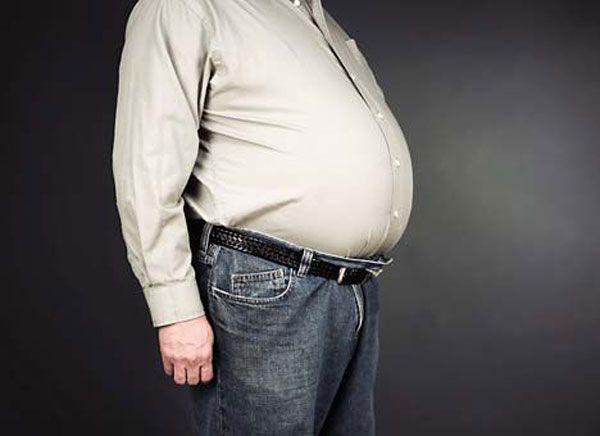 почему болит жир на животе